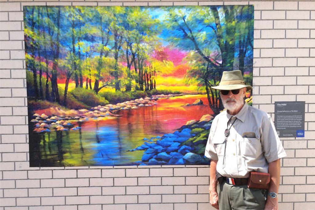 Thomas Allen in front of mural